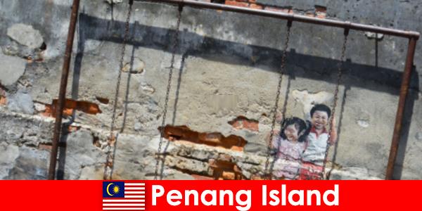 Lenyűgöző és változatos utcai művészet Penang-szigeten elképeszt idegenek