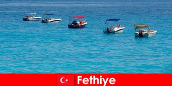 Törökország Kék utazás és a fehér strandok türelmetlenül várják Fethiye turisták kikapcsolódásra