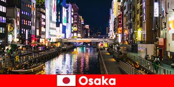 Szórakoztató negyedek és finomságok várják a külföldi utazókat Oszakában Japánban